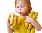 girl with bananaisolated on white