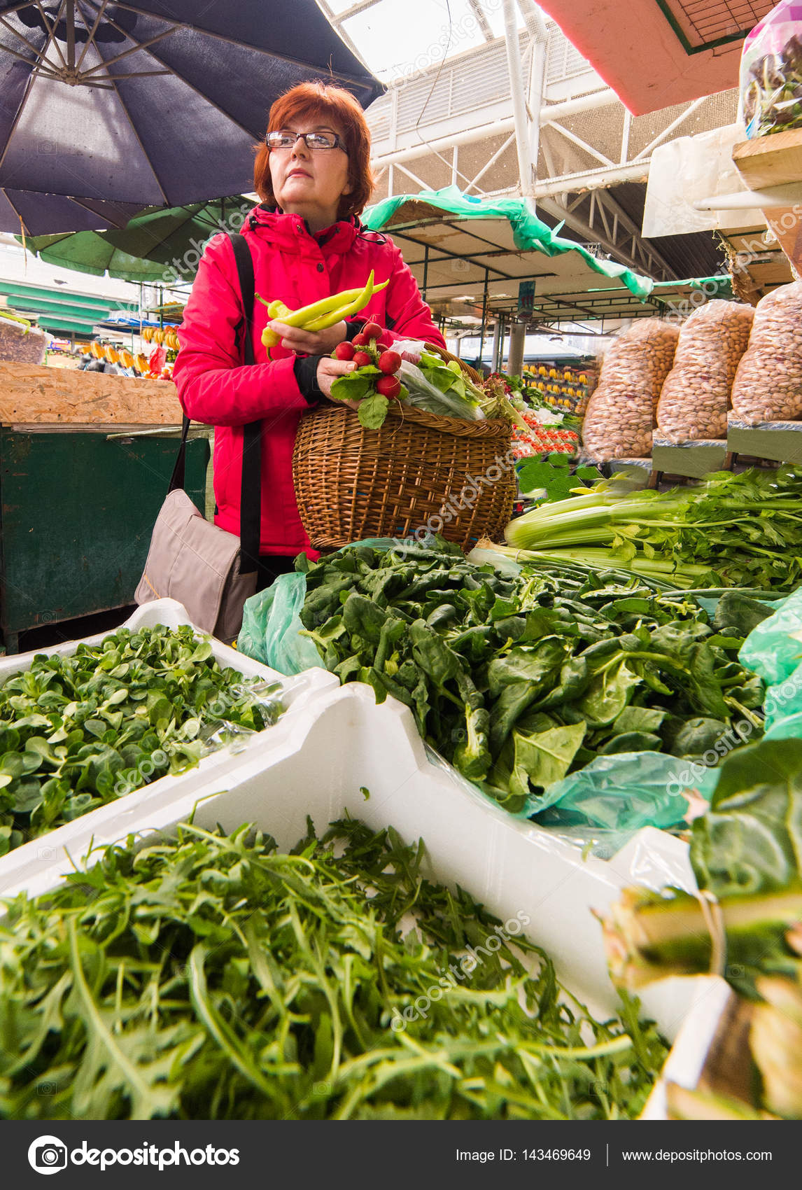Woman buying lettuce at market place