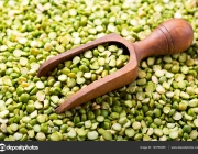 Dried green peas with wooden scoop