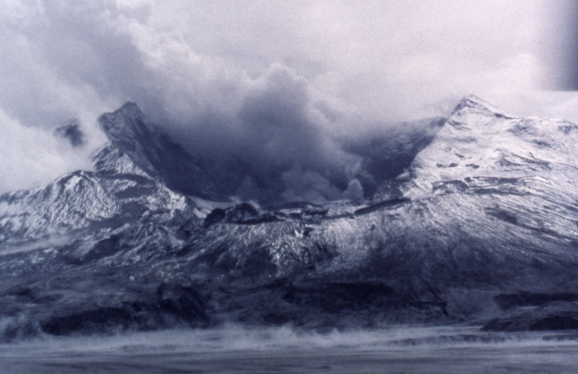 Earliest view of the north side of gutted mountain with enormous crater;